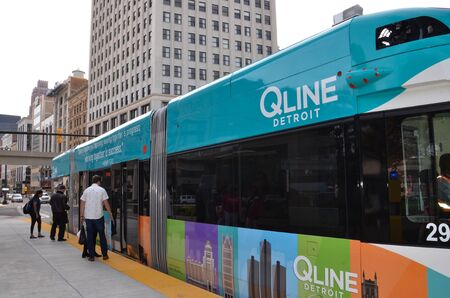 DETROIT, MI  USA - OCTOBER 21, 2017:  Riders board Detroit's QLine, which runs along Woodward Avenue in downtown Detroit.