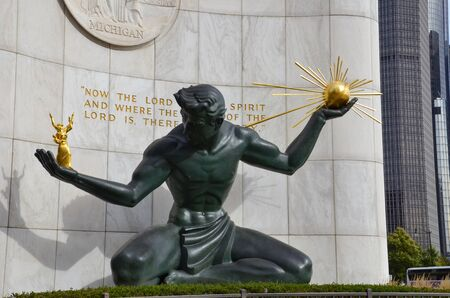 DETROIT, MI  USA - OCTOBER 21, 2017:  The Spirit of Detroit sculpture in downtown Detroit, shown here with the Renaissance Center in the background, was restored in 2006. Sajtókép