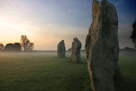 standing stones: Mystical Standing Stones at Dawn, Avebury  Stock Photo