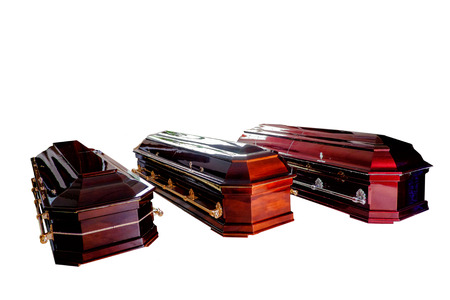 Three closed wooden coffins isolated on white background Stock Photo