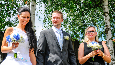 Prague, Czech Republic, July 29, 2017, the bride groom and guests at a rural wedding day