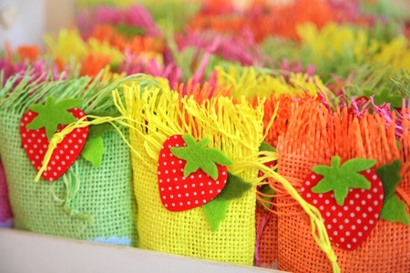 Small color baskets with sugar sweets for gifts