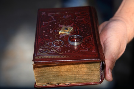 wedding rings on a book photo