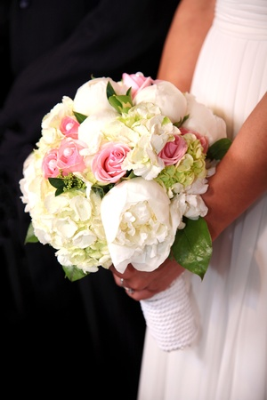 Bride holding her bouquet at her wedding Stock Photo