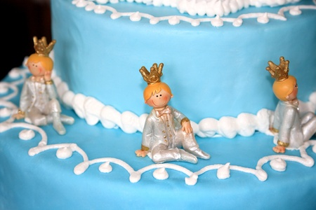 Birthday cake decorated with small princes photo