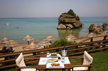 lunch on a table for two  at restaurant by the sea