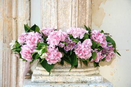 mauve flowers decorate a column