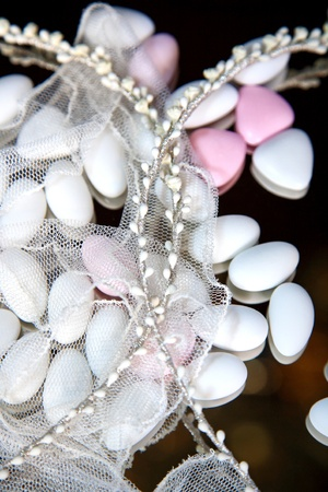 close-up of wedding crowns and almond sweets cover with veil Stock Photo - 11068607