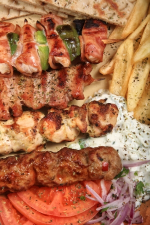 taverns: barbeque mix griil served with fries tzatziki and pita on a greek style Stock Photo
