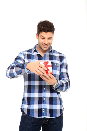 handsome man portrait with a gift in his hands Stock Photo - 11546172