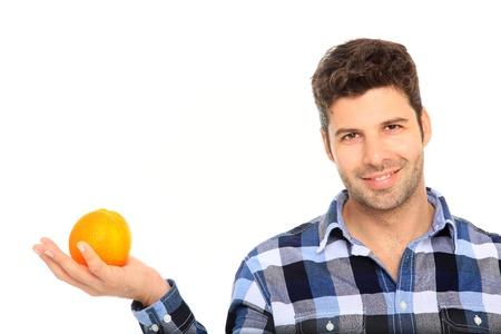 happy man holding orange in his hand photo