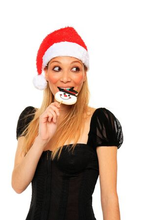 young sexy girl eating a christmas candy isolated on a white background Stock Photo - 11546163