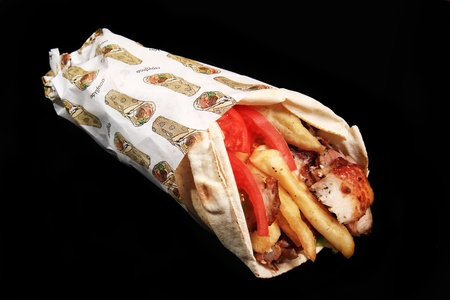 chicken served on tortillia with fries and tomato