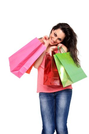 happy young girl holding shopping bags isolated on a white background Stock Photo - 11941351