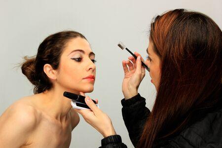 make up artist: make up artist and model backstage