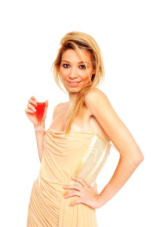 blondie: happy woman holding a glass of red champagne isolated on a white background