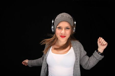 happy girl with headphones listening music Stock Photo - 11940717