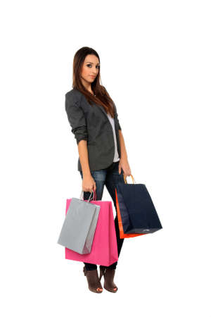 beautiful young girl holding shopping bags isolated on a white background Stock Photo - 11940706