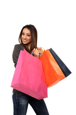 happy young girl holding shopping bags isolated on a white background Stock Photo - 11940712