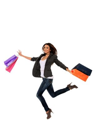 happy young girl holding shopping bags isolated on a white background Stock Photo - 11940704