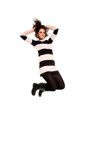 happy young girl jumping isolated on a white background