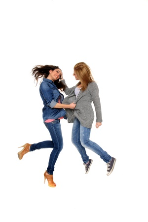 two young girls are fighting with each other photo