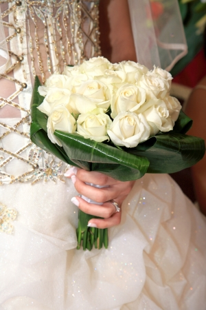 bride holding the wedding bouquet photo