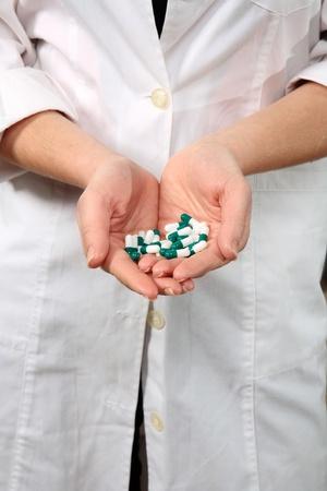 pharmacist holding pills indoor