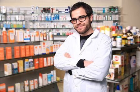 portrait of young handsome pharmacist