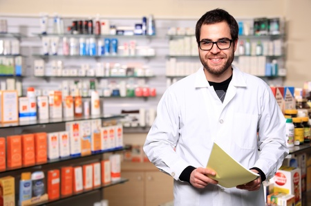 portrait of young handsome pharmacist photo