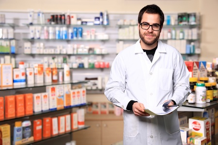 pharmacist: portrait of young handsome pharmacist
