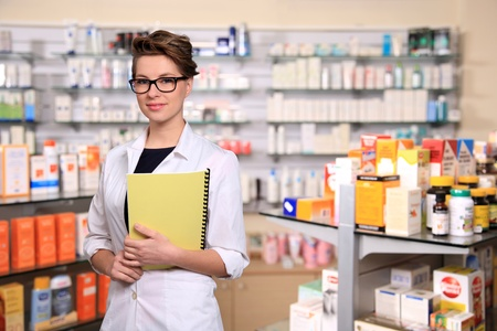 portrait of beautiful young pharmacist photo