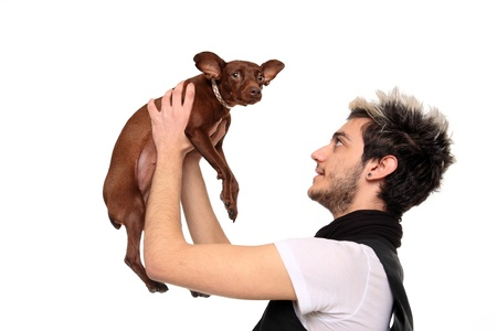 young man posing with pinscher isolated on a white background Stock Photo