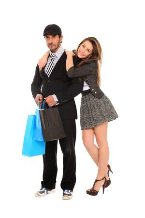 young stylish couple with shopping bags photo