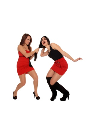 girl fighting: two happy beautiful girls posing together Stock Photo