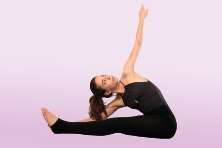 yoga instructor isolated on a pink background Stock Photo - 13925816