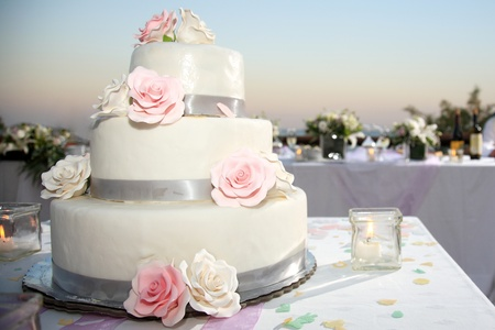 wedding cake: wedding cake beautiful decorated with roses Stock Photo