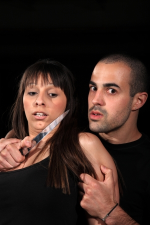 criminal kidnapping a girl with a knife Stock Photo - 13927751