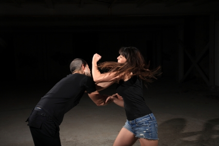martial arts female instructor exercising with young man photo