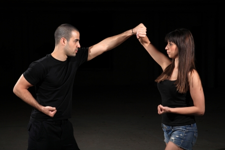 jujitsu: martial arts female instructor exercising with young man