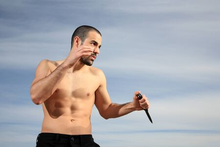 martial arts instructor exercising with a knife outdoor Stock Photo - 13927522