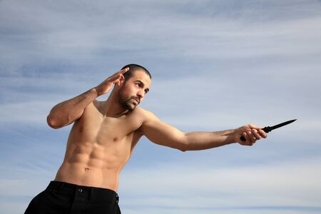 martial arts instructor exercising with a knife outdoor Stock Photo - 13925923