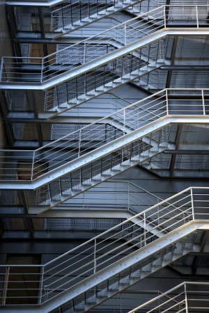 emergency evacuation metalic stairs at the back side of building Stock Photo