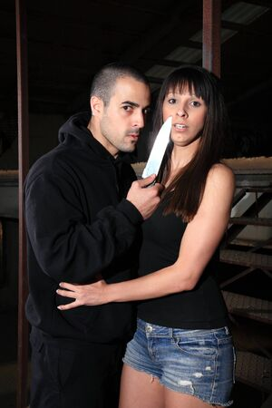 criminal kidnapping a girl with a knife photo