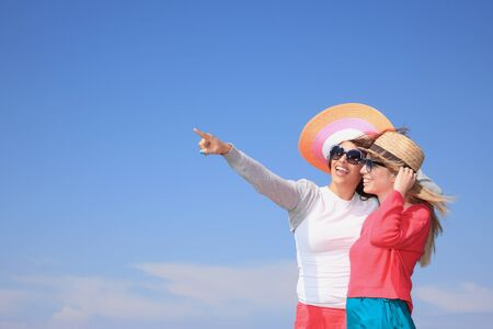 beautiful young girls with hats and having fan outdoor Stock Photo - 14902965