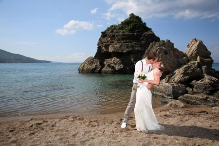 portrait of a bride and groom on the beach photo
