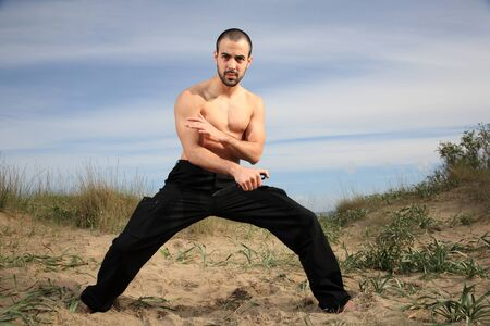 martial arts instructor exercising with a knife outdoor Stock Photo - 15608621