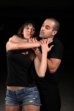 defence: martial arts female instructor exercising with young man