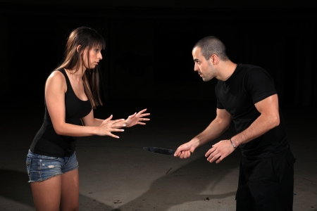 self defense: martial arts female instructor exercising with young man