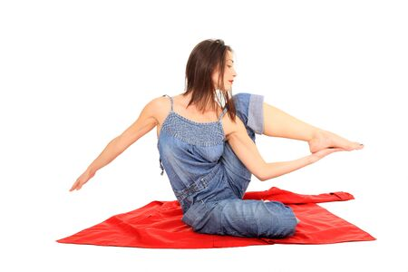 young girl stretching isolated on a white background